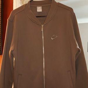 Nike men's olive tan Small sweater, fits big.
